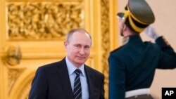 Russian President Vladimir Putin arrives to cheir a meeting of a committee on preparations for upcoming Victory Day in WWII, in Moscow's Kremlin, Russia, on April 5, 2016.