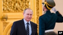 FILE - Russian President Vladimir Putin is seen in Moscow's Kremlin, Russia, in a April 5, 2016, photo.