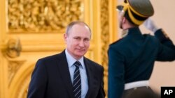 FILE - Russian President Vladimir Putin arrives to chair a meeting, in Moscow's Kremlin, Russia, April 5, 2016.