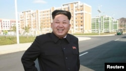 North Korean leader Kim Jong Un tours the newly built Wisong Scientists Residential District in this undated photo released by North Korea's Korean Central News Agency, in Pyongyang, Oct. 14, 2014.