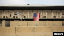 FILE - A U.S. flag hangs off of a housing unit inside of Bagram Air Field in the Parwan province of Afghanistan, Jan. 2, 2015.