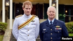 Britain's Prince Harry (L) stands with the chief of the Australian Defence Force Air Chief Marshal Mark Binskin after he arrived at the Duntroon Royal Military College in Canberra, April 6, 2015.