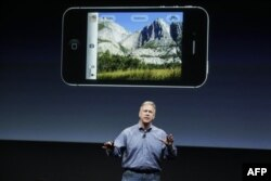 Apple Phil Schiller talks about the camera on the iPhone 4S during an announcement at Apple headquarters in Cupertino, Calif., Tuesday, Oct. 4, 2011. (AP Photo/Paul Sakuma)