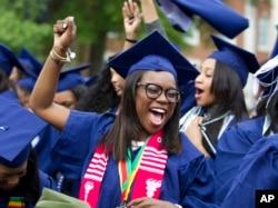 FILE - Ciearra Jefferson celebrates her graduation with her class after President Barack Obama spoke at Howard University's commencement exercises in Washington, May 7, 2016.