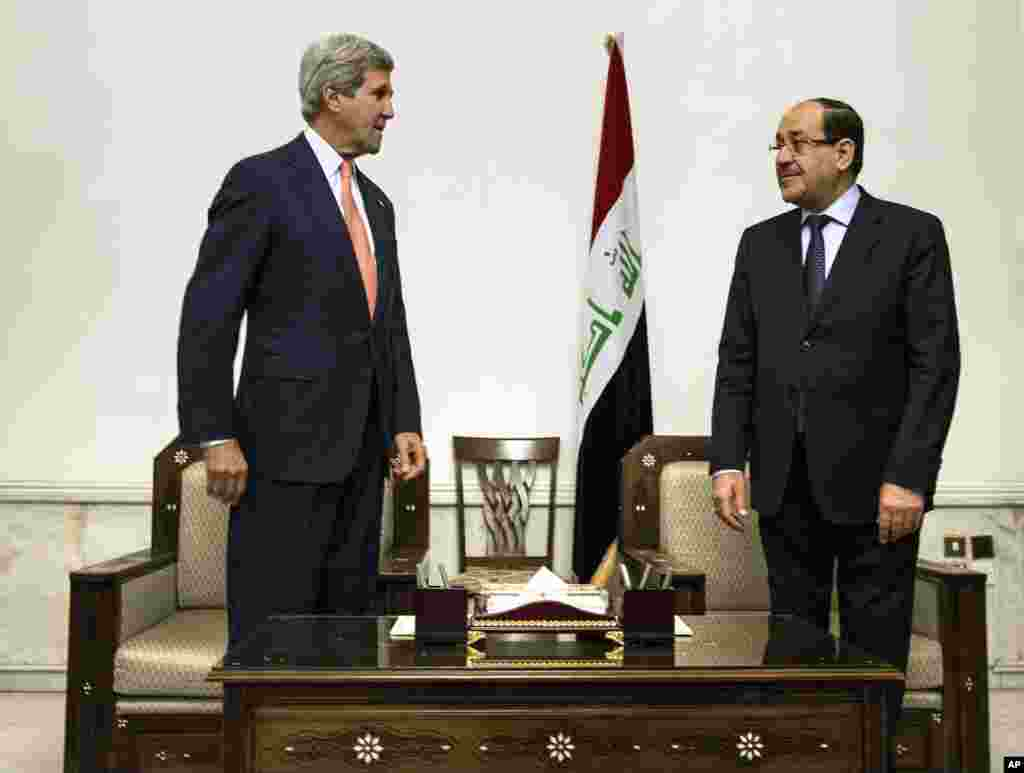 U.S. Secretary of State John Kerry meets with Iraqi Prime Minister Nouri al-Maliki in Baghdad, June 23, 2014.