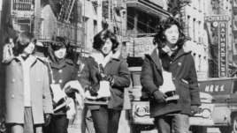 Four Chinese American girls carrying ice skates in Chinatown, New York City (April 27, 1965)