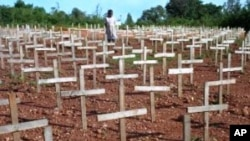 FILE - Crosses stand as a memorial to the hundreds of thousands of victims of the 1994 Rwandan genocide.