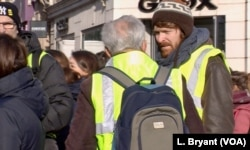 The yellow vests encompass all ages and many backgrounds.