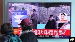 "Visitors walk by a TV screen showing a news program with a file footage of North Korean leader Kim Jong Un at the Seoul Train Station in Seoul, South Korea, March 22, 2017. North Korea's latest missile launch ended in failure Wednesday. The Korean letters read: ""Launch a missile."""