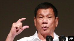 FILE - Philippine President Rodrigo Duterte delivers a speech.
