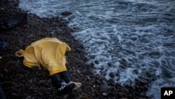 FILE - Plastic sheeting covers the body of an unidentified boy near Skala, a village on the Greek island of Lesbos, Nov. 1, 2015. He was among nearly 4,000 to die in attempted Mediterranean crossings this year.