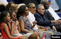 U.S. President Barack Obama and his family react along with Cuban President Raul Castro
