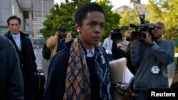 Hip hop artist Lauryn Hill leaves United States Court after a sentencing on federal tax evasion charges in Newark, New Jersey, May 6, 2013.