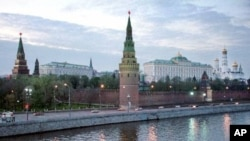 Kremlin's Borovitskaya, left, Vodovvodnya, center, towers, Grand Kremlin Palace, center, and Ivan the Great Bell Tower, highest at right, are in the picture