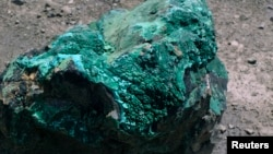 A piece of malachite, a copper ore, is seen at the bottom of Congolese state mining company Gecamines' Kamfundwa open pit copper mine, Jan. 31, 2013.