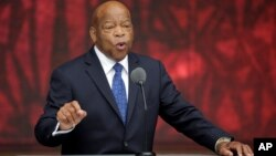 U.S. Rep. John Lewis, D-Georgia, speaks at the dedication of the Smithsonian's National Museum of African American History and Culture in Washington, D.C., Sept. 24, 2016. Lewis won a National Book Award for a graphic novel about his civil rights activism.