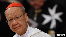 FILE - New Cardinal John Tong Hon of China attends a consistory mass in St Peter's Basilica at the Vatican February 19, 2012. (REUTERS/Tony Gentile)