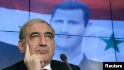 Phó Thủ tướng Syria Qadri Jamil tại cuộc họp báo ở Moscow, 21/8/13