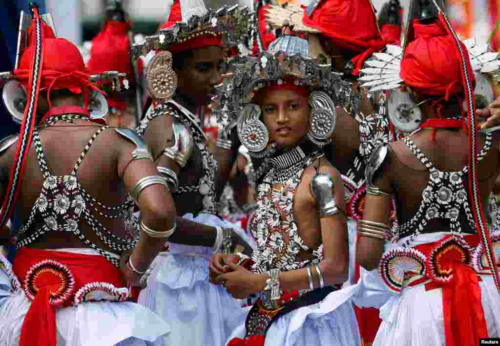 School boys who attend Sri Lankan traditional dance training wait for their graduation ceremony at a Buddhist temple in Colombo.