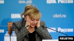 Ella Pamfilova, head of the Central Election Commission, reacts as she addresses the media after poll close in the Russian parliamentary election, at the commission's headquarters in Moscow, Sept. 19, 2021.