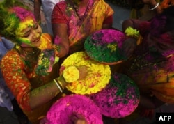 Indian students play with coloured powders to celebrate Holi festival in Kolkata on March 1, 2018.