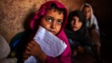 Girls attend lessons at a school in a slum on the outskirts of Islamabad October 11, 2013. REUTERS/Zohra Bensemra (PAKISTAN - Tags: EDUCATION SOCIETY POVERTY TPX IMAGES OF THE DAY) - RTX1472X