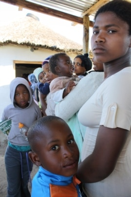Patients wait to see the nurse inside the health point at Masizini (D. Taylor/VOA)