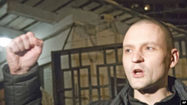 Russian opposition leader Sergei Udaltsov greets his supporters after he was released from a detention center in Moscow, Jan. 4, 2012.