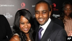 "FILE - Bobbi Kristina Brown and Nick Gordon attend premiere party for ""The Houstons On Our Own"" at the Tribeca Grand hotel in New York."