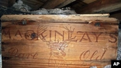 Undated photo provided by Antarctic Heritage Trust via the Canterbury Museum, a whisky crate is stored beneath the floor of a hut built by British explorer Sir Ernest Shackleton during his 1908 Antarctic expedition