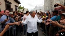 FILE - Mexico's President-elect Andres Manuel Lopez Obrador greets supporters in Mazatlan, Mexico, Sept. 16, 2018.