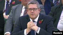 FILE - Andrew Parker, head of M15, is seen attending an Intelligence and Security Committee hearing at Parliament, in this still image taken from video in London, Nov. 7, 2013.