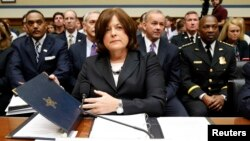 "FILE - U.S. Secret Service Director Julia Pierson takes her seat to testify at the House Oversight and Government Reform Committee hearing on ""White House Perimeter Breach: New Concerns about the Secret Service"" on Capitol Hill, Sept. 30, 2014."
