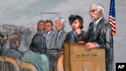 In this courtroom sketch, Boston Marathon bombing suspect Dzhokhar Tsarnaev, second from right, is depicted with his lawyers, left, beside U.S. District Judge George O'Toole Jr., right, as O'Toole addresses a pool of potential jurors in a jury assembly room at the federal courthouse in Boston, Jan. 5, 2015.
