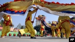 FILE - Dragon dances are performed during Dong Da Festival in Hanoi, Vietnam, 2009.
