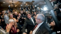 Observed by the media Ousted Catalan president Carles Puigdemont arrives for a presentation of the candidate list for the Catalan regional elections in Oostkamp, Belgium, Saturday, Nov. 25, 2017.