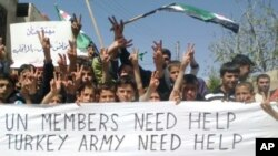 Handout photo released by Shaam News Network shows an anti-Assad demonstration in Hass in Idlib province on April 20, 2012.