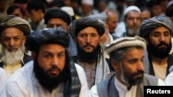 Afghan men attend a gathering launched by a political party ahead of an election campaign in Kabul, Sept. 3, 2013.