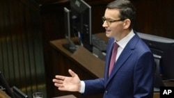 Poland's new Prime Minister Mateusz Morawiecki gives his policy speech in the parliament in Warsaw, Poland, Dec. 12, 2017.