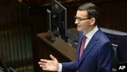 FILE - Poland's Prime Minister Mateusz Morawiecki gives his policy speech in the parliament in Warsaw, Poland.
