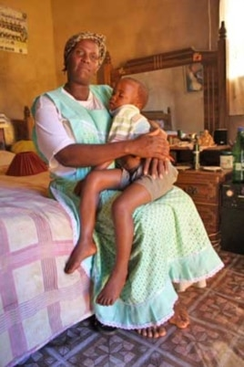 HIV infected mother Cynthia Mkhize clutches her son, Bongamusa.... Fortunately, the boy has been born without HIV....