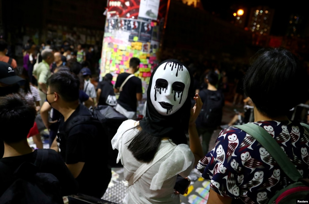 An anti-government protester wears a mask on the back of her head during a demonstration in Wong Tai Sin district, in Hong Kong, China.