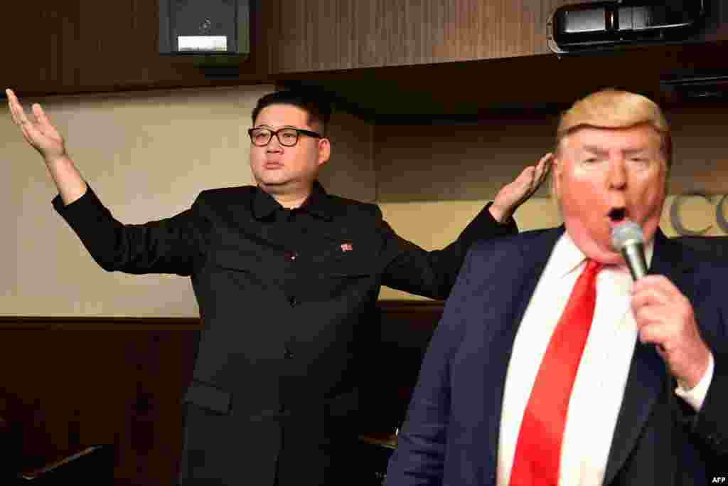 Impersonators of North Korean leader Kim Jong Un (L) and U.S. President Donald Trump perform at a bar in Osaka, ahead of the G-20 summit.