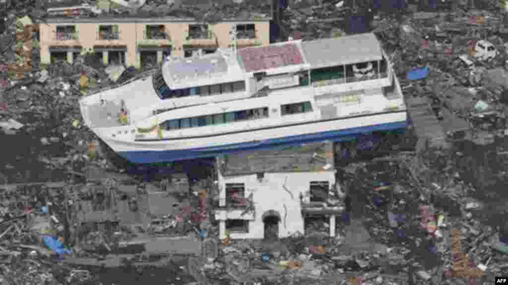 A ferry stranded on a building is seen in Otsuchi, Iwate Prefecture, northern Japan, Sunday, March 13, 2011, two days after a powerful earthquake-triggered tsunami hit the country's east coast. (AP Photo/The Yomiuri Shimbun) JAPAN OUT, CREDIT MANDATORY