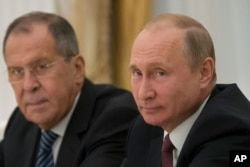 FILE - Russian President Vladimir Putin, right, and Russian Foreign Minister Sergey Lavrov attend talks with U.S. National security adviser John Bolton in the Kremlin in Moscow, Russia, June 27, 2018.