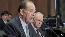 Thomas Kean (L), and Lee Hamilton, former co-chairmen of the 9/11 Commission, testify before the U.S. Senate Homeland Security and Governmental Affairs Committee hearing on the 10-year report on circumstances surrounding Sep 11, 2001 terrorist attacks, Ma