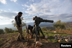 Turkish-backed Free Syrian Army fighters prepare a TOW anti-tank missile north of the city of Afrin, Syria Feb. 18, 2018.