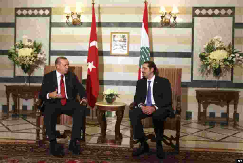 Lebanese Prime Minister Saad Hariri, right, meets with his Turkish counterpart Recep Tayyip Erdogan, left, at the Government House in Beirut, Lebanon, Wednesday, Nov. 24, 2010. Erdogan arrived in Beirut on Wednesday on a two-day visit. (AP Photo/Bilal Hus