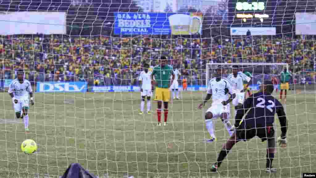 Nigeria's Emmanuel Emenike (9) scores past Ethiopia goalkeeper Jemal Tasew during their 2014 World Cup qualifying match.