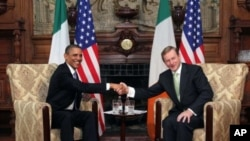 US President Barack Obama, left, and Taoiseach Enda Kenny shake hands during talks in Farmleigh, Dublin, May 23, 2011